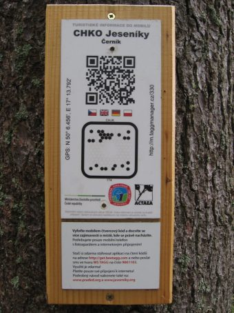 Czech hiking trail marker with QR code and Beetagg, Jeseniky mountain hiking trail, Czech Republic