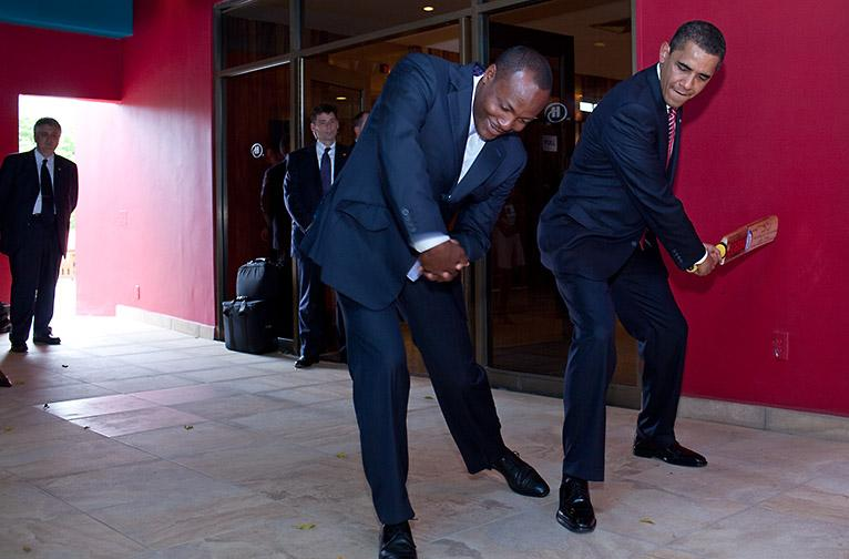 World-famous cricket legend Brian Lara shows President Barack Obama how to properly swing a bat during the Summit of the Americas in Port of Spain on 19 April, 2009, at a press conference at Hilton Hotel. White House photo by Pete Souza
