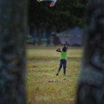 A child flies a kite on the Queen's Park Savannah. Photo by Chris Anderson