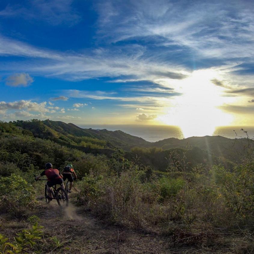 Riding into the sunset. Photo: Daniel Knecht, instagram.com/2radwanderer. Courtesy Tobago Mountain Bike Tours