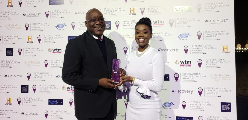 Chief Secretary Kelvin Charles and Secretary Nadine Stewart-Phillips are pictured with the Silver Award