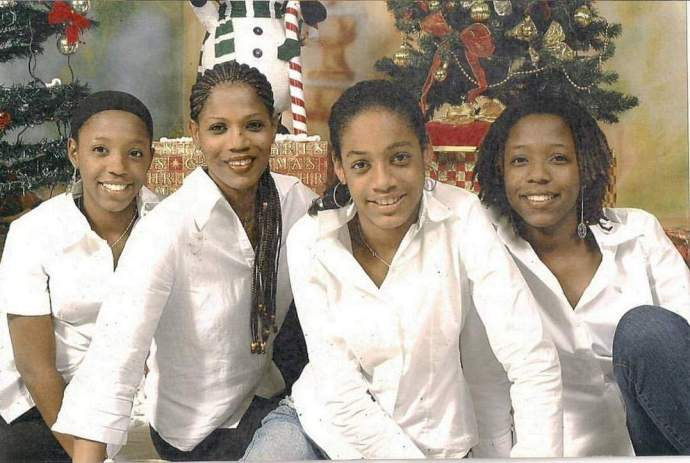 Paige with mother Jacqueline and twin sisters Anika (left) and Rianna (right). Photo courtesy the Johnson family