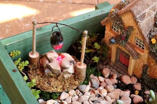 miniature garden firepit and cooking pot