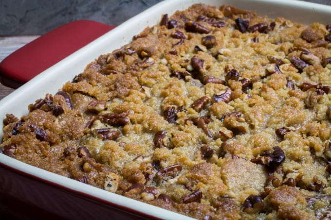 This traditional Thanksgiving casserole recipe uses baked sweet potatoes mashed together with brown sugar and autumn spices, then topped with a sweet and crunchy layer of crumble and pecans. A touch of maple syrup brings the rich, buttery taste of this Easy Sweet Potato Casserole with Pecan Crumble Topping to the next level! This really is the perfect side dish for your holiday table.