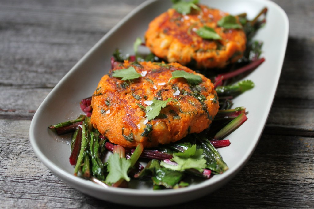 Foodies rejoice, you can have your lawn and eat it too! Celebrate the first signs of Spring with these Sweet Potato Patties on Sautéed Dandelion Greens. The sweet nature of the Sweet Potato Patties are a perfect companion to the bitter dandelion greens. Season with coarse flaky salt and enjoy! #vegan #sweetpotatoes #dandelion #foraged