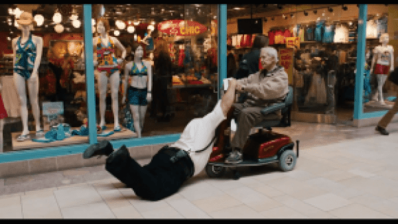 Kevin James tackles an old mans scooter as holiday workers do