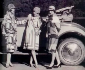 3 flappers in graphic knits and a car