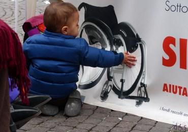il gazebo del galm in piazza bra a verona per la Giornata Nazionale della Persona con Lesione al Midollo Spinale