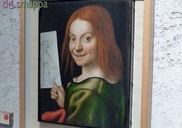 Giovan Francesco Caroto, Ritratto di giovane con disegno infantile, Museo di Castelvecchio Verona