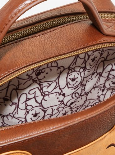 199c052796d And how adorable is this Winnie the Pooh crossbody bag  The interior lining  even has an allover Pooh Bear print which is oh so cute! I am very tempted  to ...