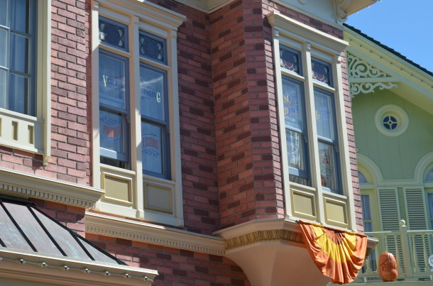 This window on Main Street USA is open and you can hear sounds coming from inside.