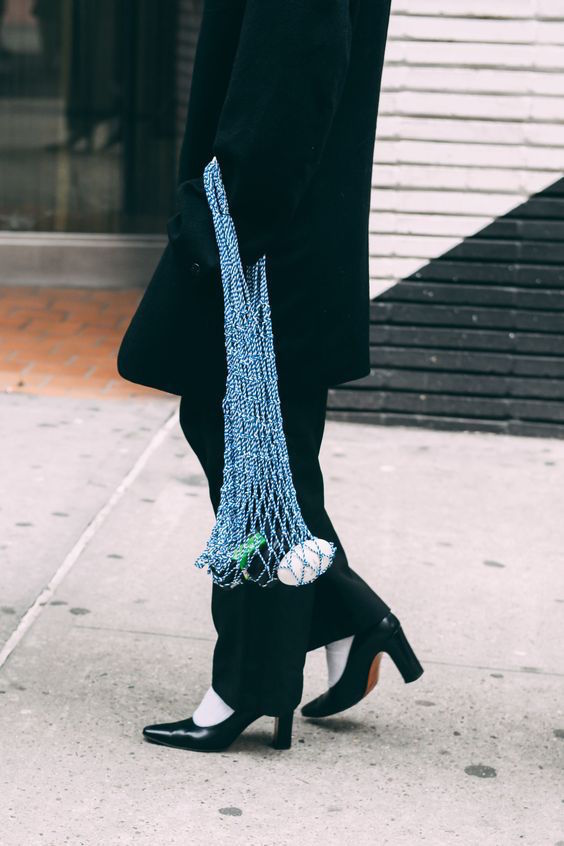net bag at Fashion Week streetstyle shot by Tommy Ton