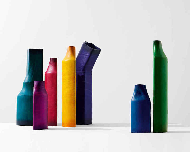 boiled leather vases by Simon Hasan