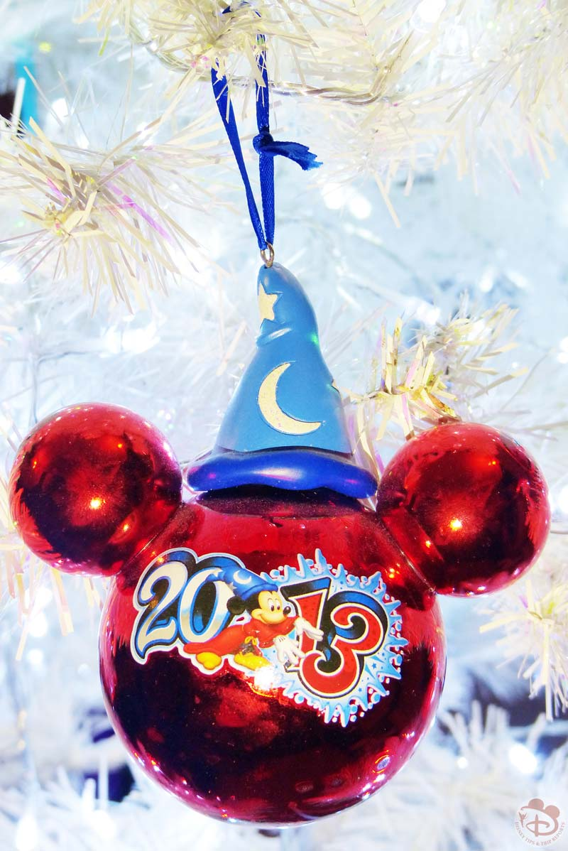 with the ornaments with the year on them they are similar in style the mickey head silhouette with the year stamped on the front and mickey mouse - Disney Christmas Ornaments