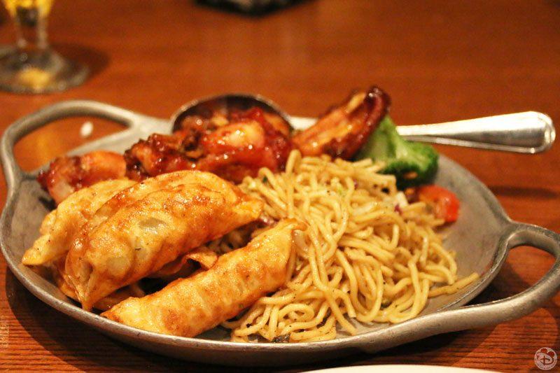 Pork Dumplings tossed in Garlic-Ginger Sauce