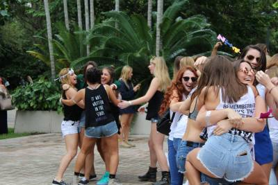 Sorority sisters rush to the new members of their sisterhood on the Rock Patio. For the rest of the day, sisters get to meet other new pledges and sisters. Source: Facebook, Panhellenic at the University of Miami.