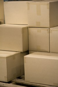 bigstockphoto_Stack_Of_Boxes_In_A_Warehouse_2342460
