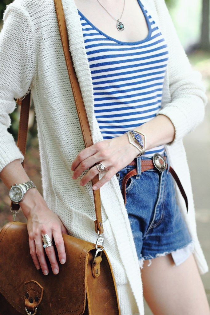 striped top, cut-offs, and silver jewelry