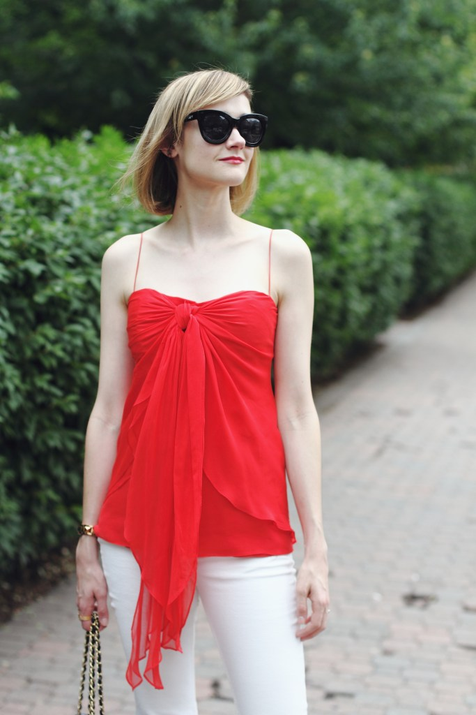 red top and cat eye sunglasses