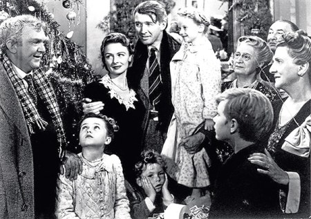 """FILE--James Stewart, center, is shown in the last scene of Frank Capra's 1947 film """"It's A Wonderful Life"""".  Hollywood columnist Army Acherd reported the actor died Wednesday, July 2, 1997 at his home in Beverly Hills.  He was 89. (AP Photo/File)"""