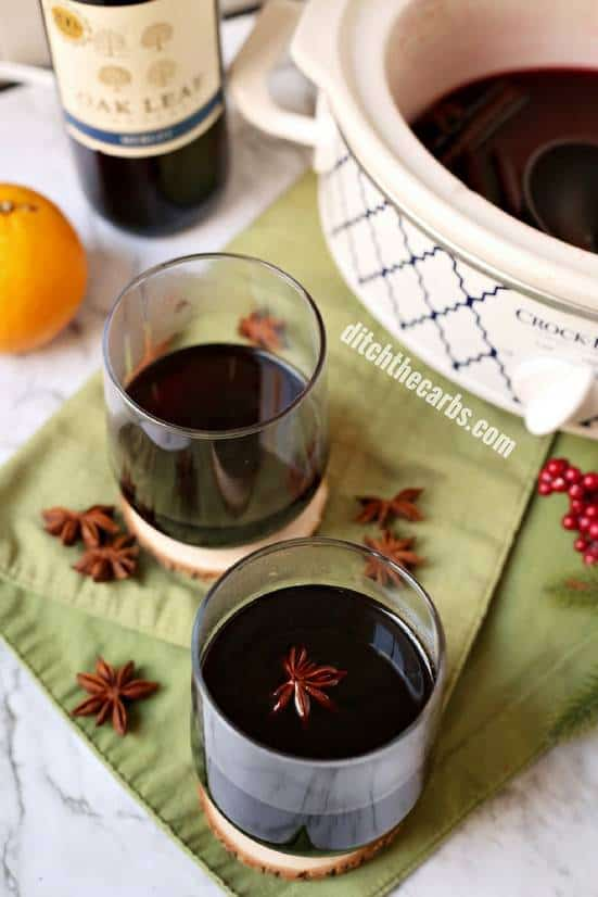 Easy CHEAT'S recipe for slow cooker low-carb mulled wine. Don't tell everyone our secret - the perfect lazy way to entertain guests this festive season. | ditchthecarbs.com