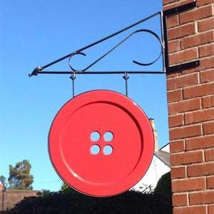 Large red button Ditzy Rose Makery sign