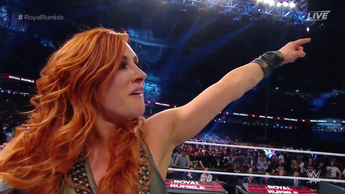 Becky Lynch Pointing at the WrestleMania Sign