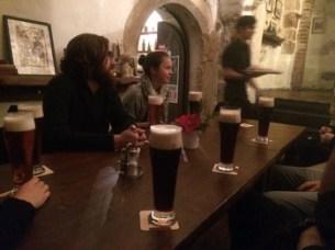 group bonding over dark beer