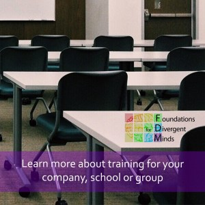 "Picture of a classroom with white tables and black chairs looking at a white screen. The Foundations for Divergent Minds logo is on the right side of the screen. Across the bottom is a purple semi-opaque rectangle with white words ""Learn more about training for your company, school or group."""