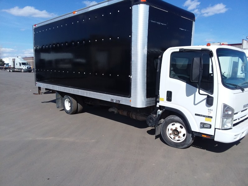 picture of white box truck with black box on a sunny day