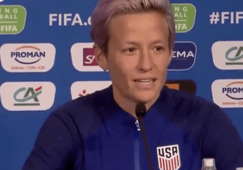 Ali Kreiger Stands with Megan Rapinoe in Skipping White