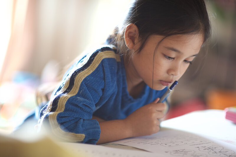Child studying to improve test scores
