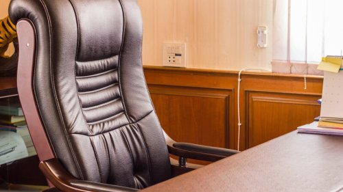 empty office chair; lack of Black leadership