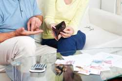 elderly couple sharing pension