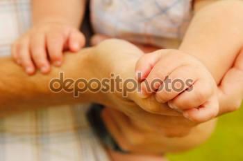 depositphotos_64218723-Parent-holds-hand-of-child