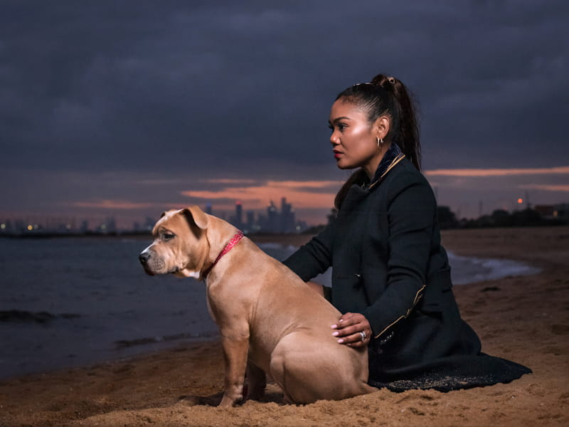 Dog and owner at Brighton Beach, Melbourne