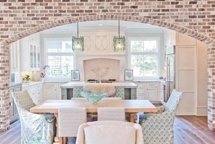 This exposed brick archway is so STUNNING! Combined with the white and sea foam colors...I just can't handle the awesome!