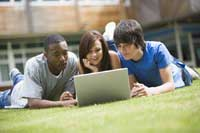Students on lawn considering Liberal Arts Colleges