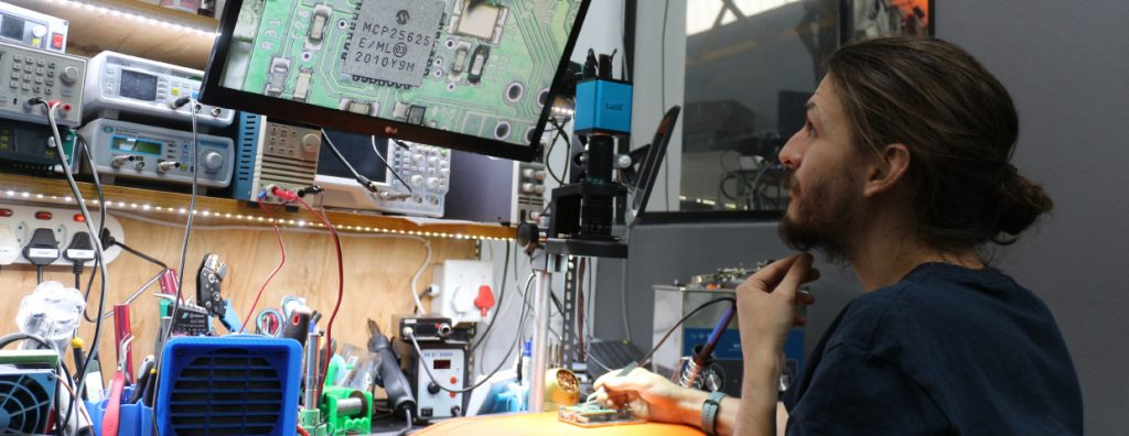 Image of man working with equipment required for Surface Mount Soldering