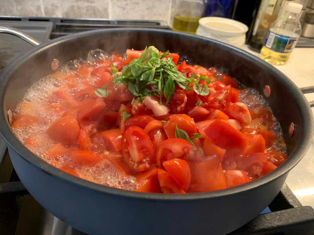 canning tomatoes for beginners - adding basil