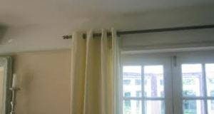 How to Put Up Curtain Rails