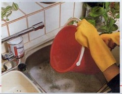 using chemicals to clear clogged sinks