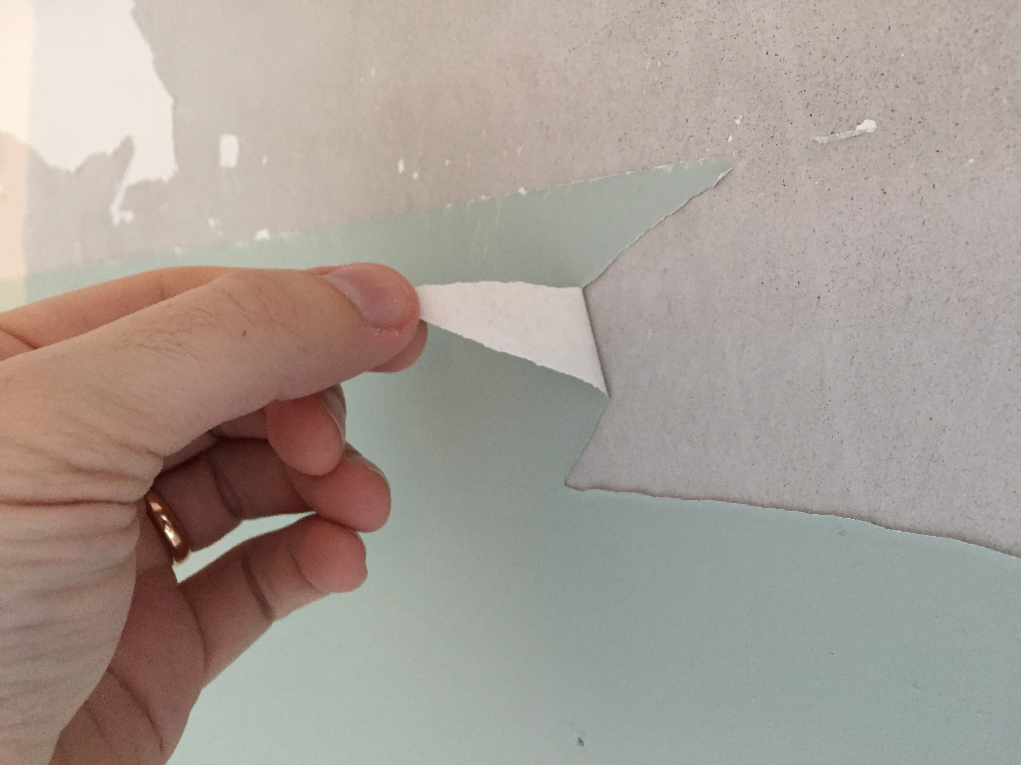 Flaking paint on new plaster wall