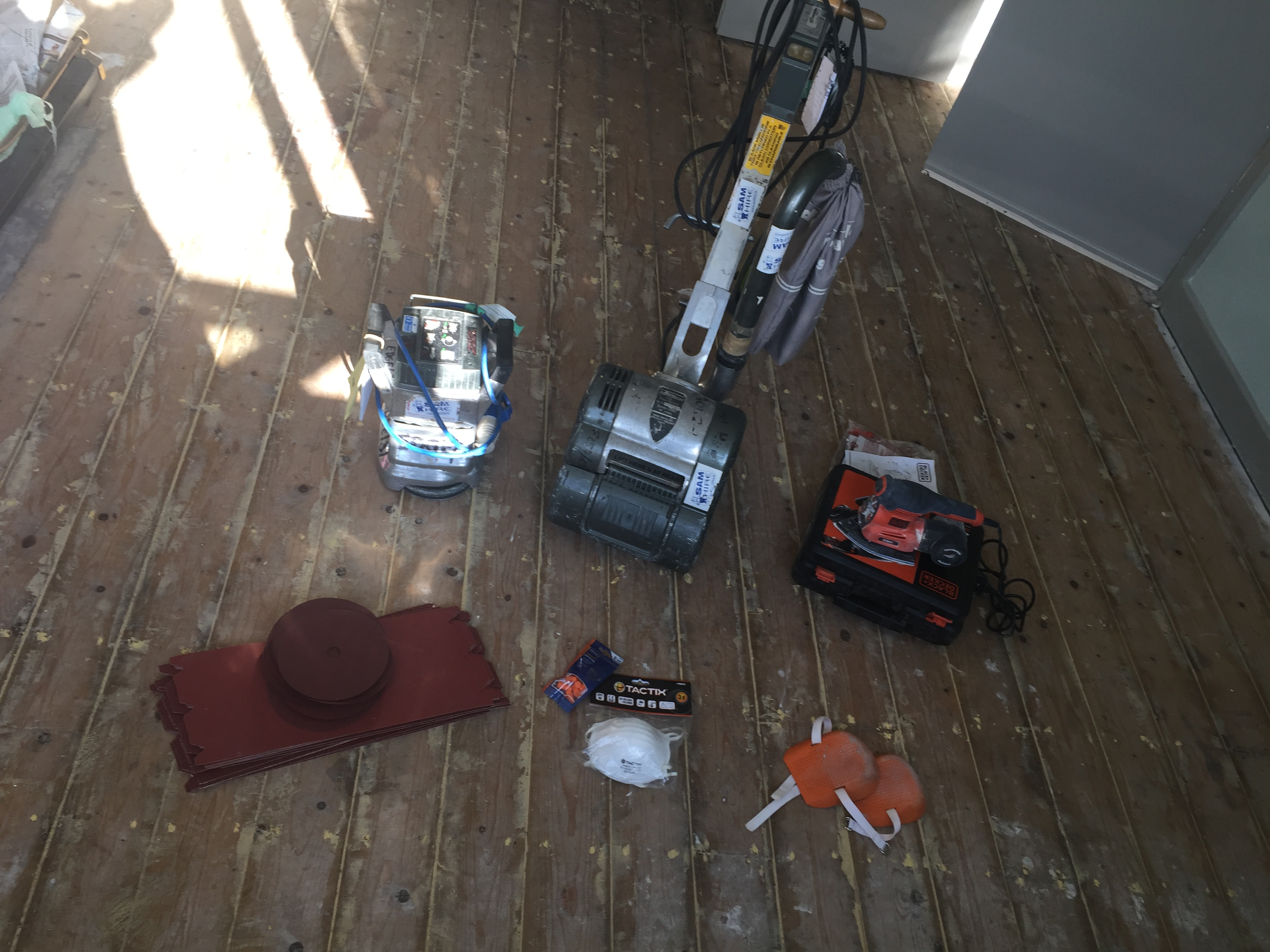 The equipment needed - a drum sander, edging sander, corner sander, sandpaper, dust mask, ear plugs and knee pads