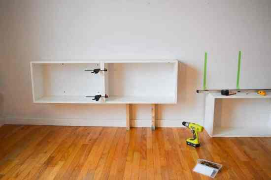 Create a DIY wall unit with stock cabinets