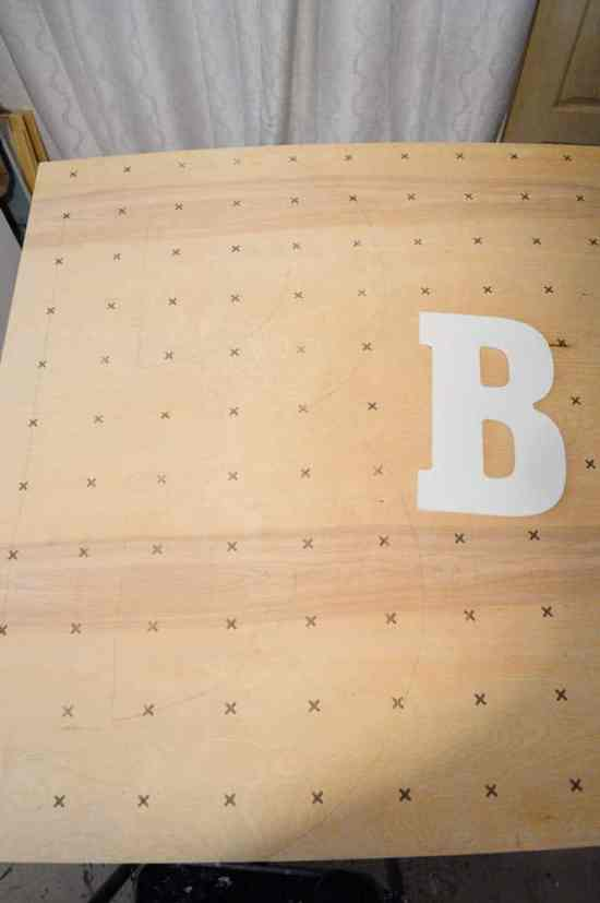 Trace your letter onto plywood