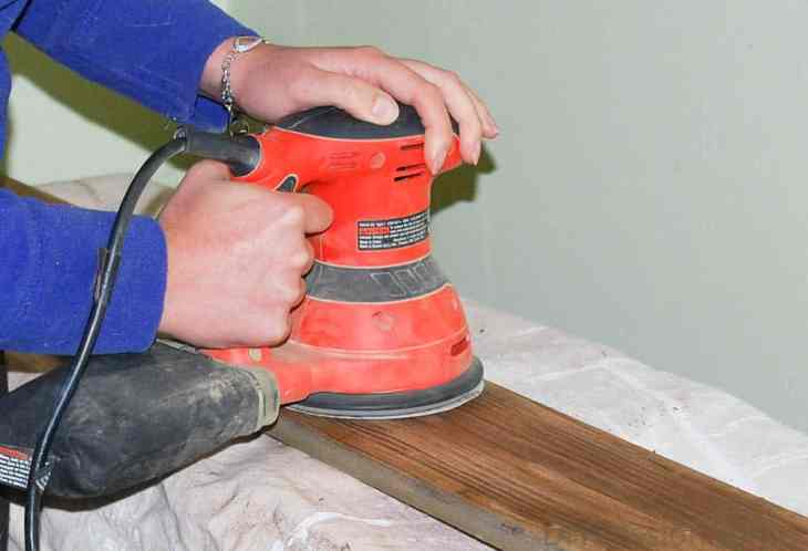 Sand fence posts again with a palm sander
