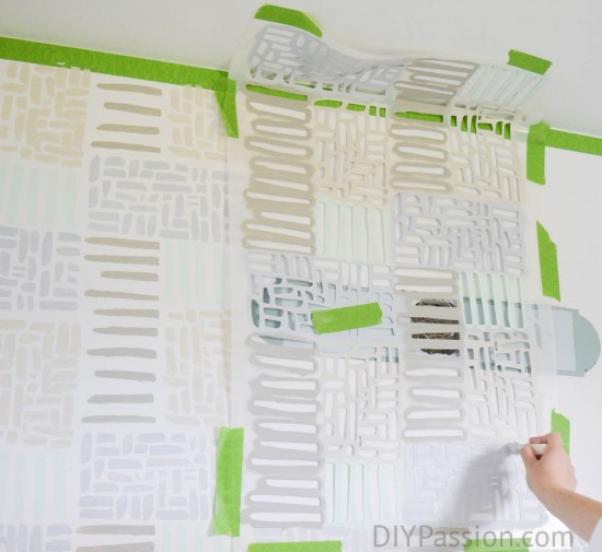 Tape your stencil around the ceiling