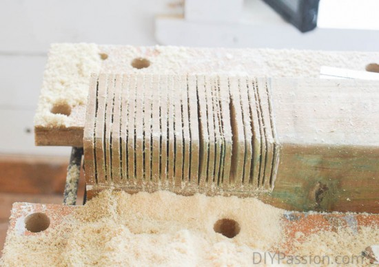 Use a chisel to pull out the sawed bits