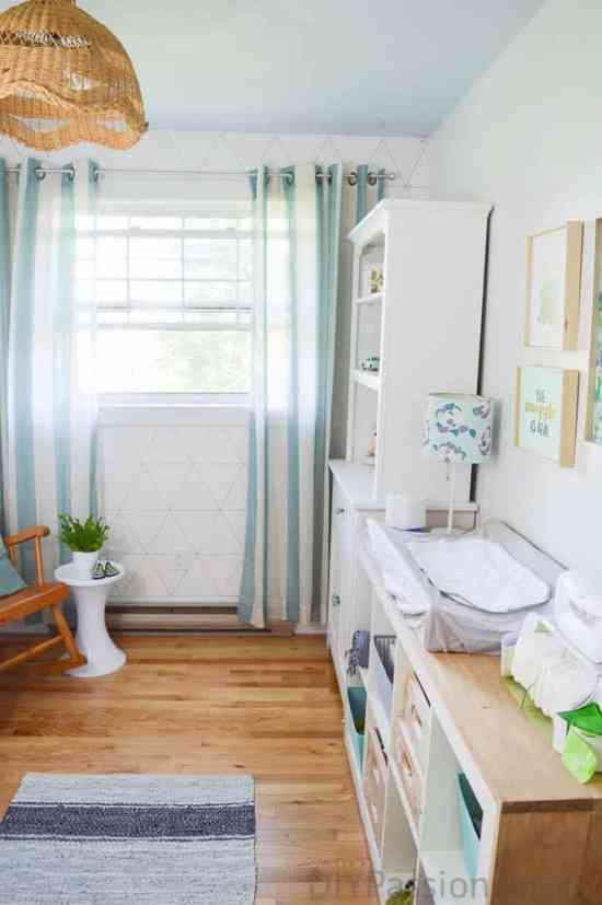 Gender Neutral Nursery with Leather Throw Rug and Wood Ikea Hack Storage